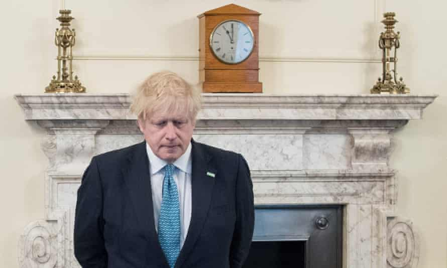 The prime minister, Boris Johnson, pauses on 28 April for a minute's silence to honour UK key workers.