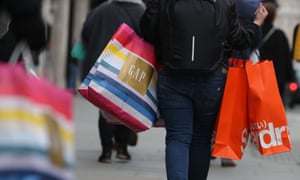 Shoppers carrying bags along Oxford Street in London.