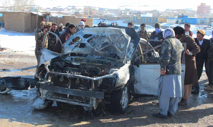 Security forces at site of previous bomb attack in Feroz Koh, capital of Ghor province, on 15 December.