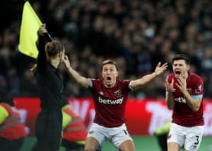 January 2: West Ham's Mark Noble and Aaron Cresswell protest with a match official during their match against Brighton.