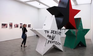 """A visitor to the Memorial To The Iraq War exhibition at the ICA, with """"Triumph"""", 2007 by Dutch artist Marc Bijl."""