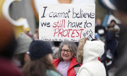 Diana Angus of Columbus holds a sign before the start of the Women's March on Washington – Ohio Sister March. The main event is expected to be among the largest marches in US history.