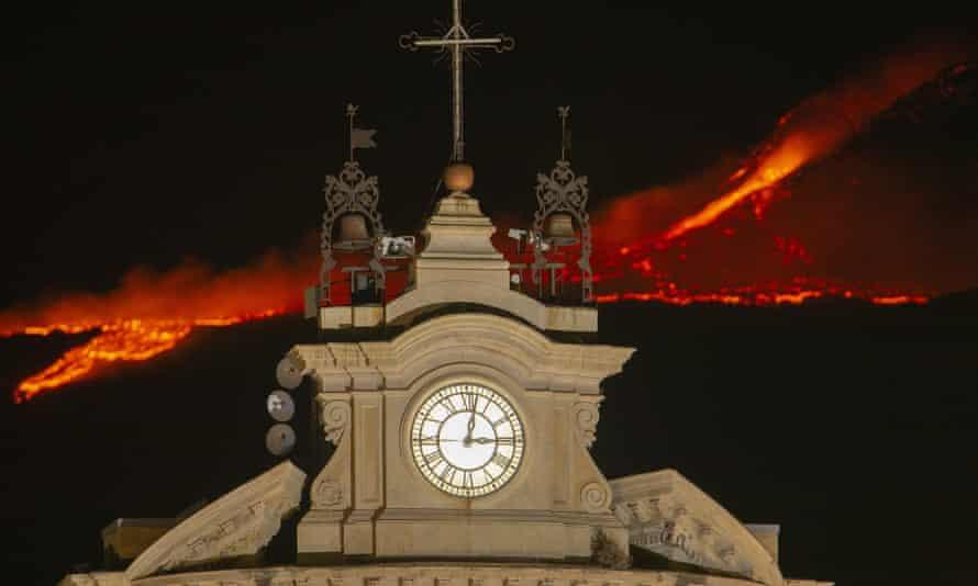 A new eruption on Mount Etna behind the Church of Santa Maria della Guardia in Belpasso, Catania
