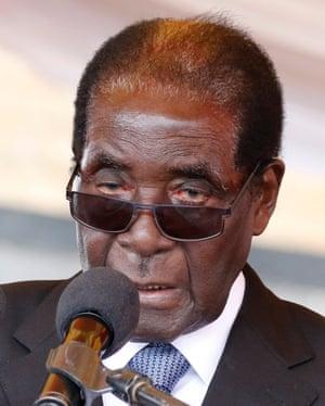 Zimbabwe's president, Robert Mugabe, addressing mourners at a funeral recently.