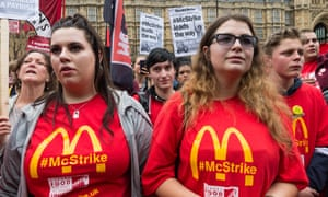 McDonald's employees and protesters outside parliament.