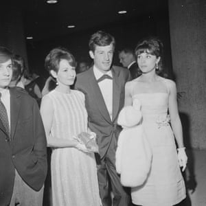 Jean-Paul Belmondo and his first wife, Elodie Constantin, with actress Françoise Arnoul (wearing the striped dress), at the International Film Festival in Berlin in June 1962