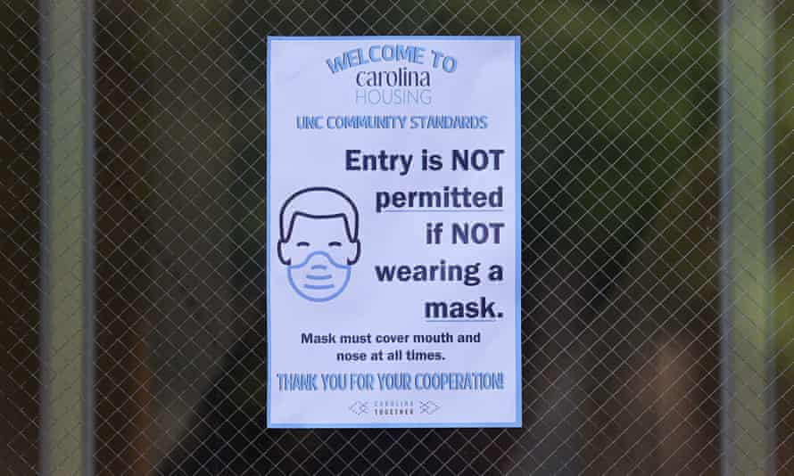 A sign is posted at the entrance to Hinton James dormitory at the University of North Carolina in Chapel Hill, North Carolina in August 2020.