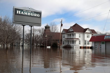 A home is surrounded by floodwater in Hamburg, Iowa. A huge flow of water breached the Missouri river levees, flooding the town.