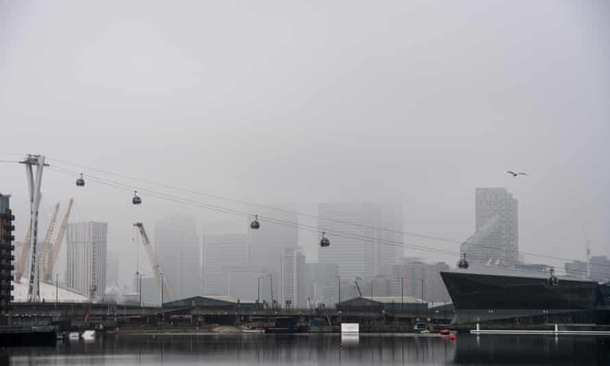 Skycrapers in the financial district of Canary Wharf are obscured by fog