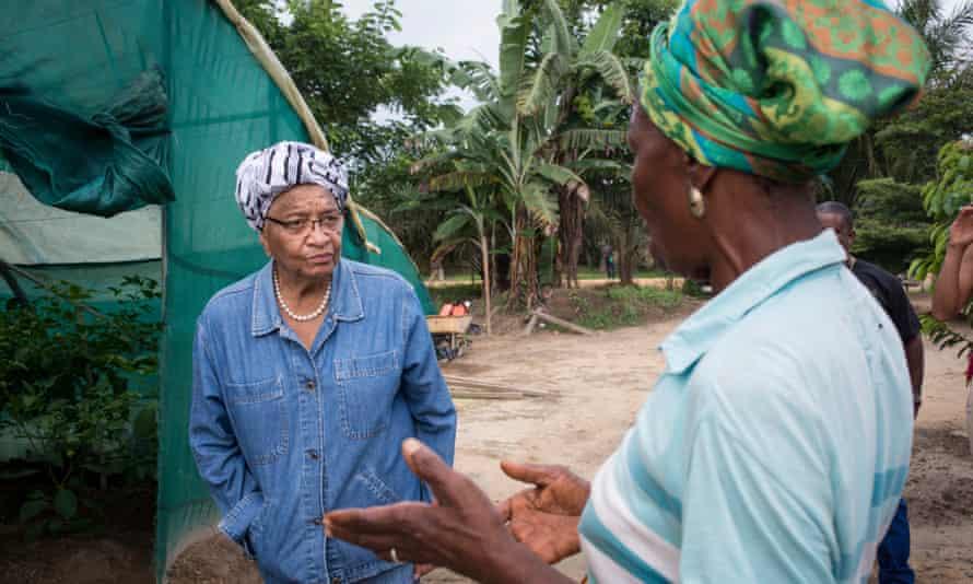 Personal appeal: Ellen Johnson Sirleaf hears a woman's appeal at her farm.