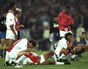 Ajax players watch the penalty shootout in the 1996 final
