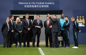 David Cameron with Chinese president Xi Jinping at Manchester City's football academy