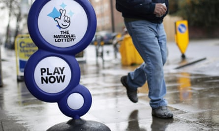 A national lottery sign outside a newsagent in north London