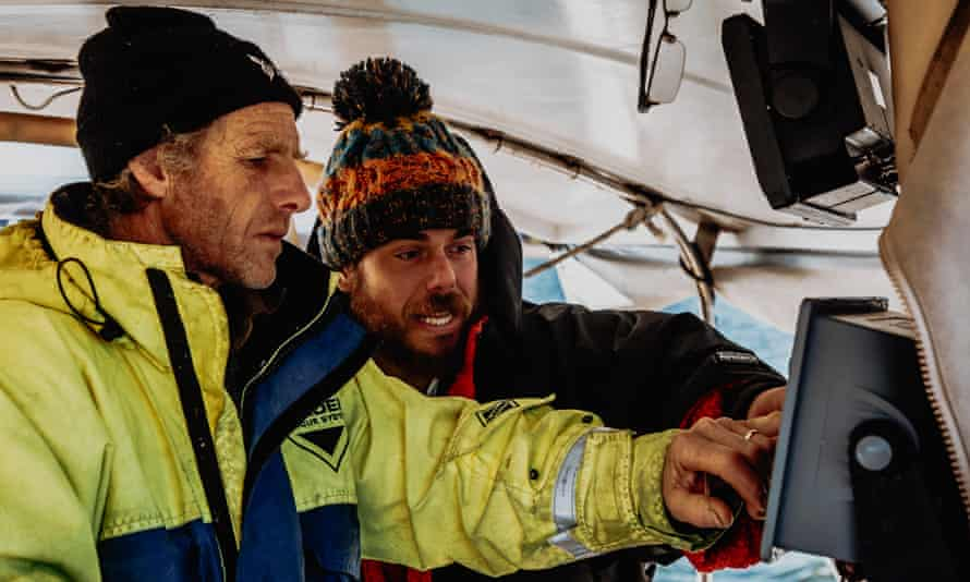 Ross Edgley with his support crew member Matt Knight, on board on board the catamaran Hecate.