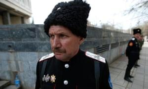 Cossacks stand guard at the Crimean parliament building in Simferopol, 2014.