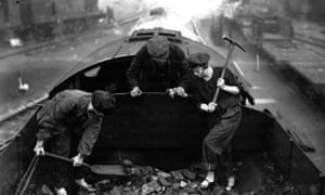 Female engine drivers turn their hand to coal shovelling during the General Strike of 1926.