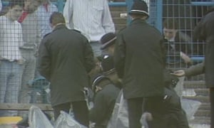 Police collect evidence shortly after the Hillsborough disaster.