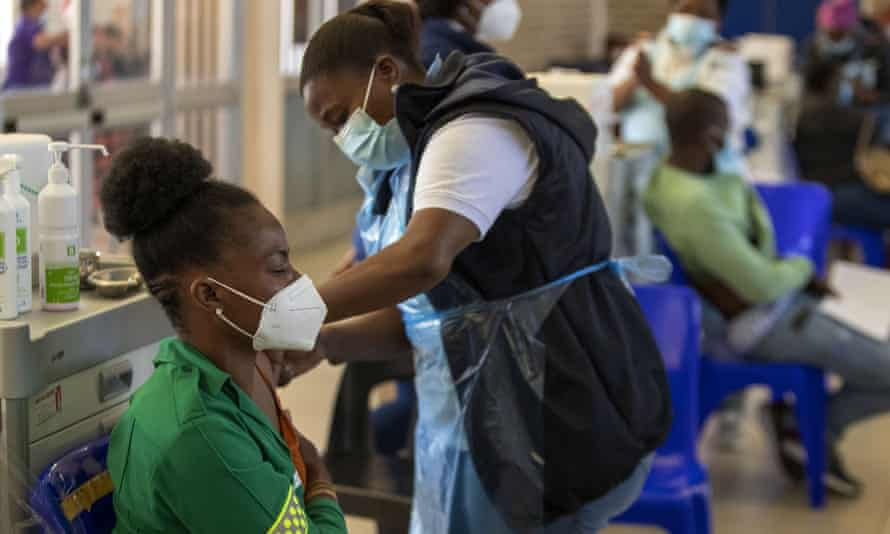 Healthcare worker being vaccinated in a Johannesburg hospital
