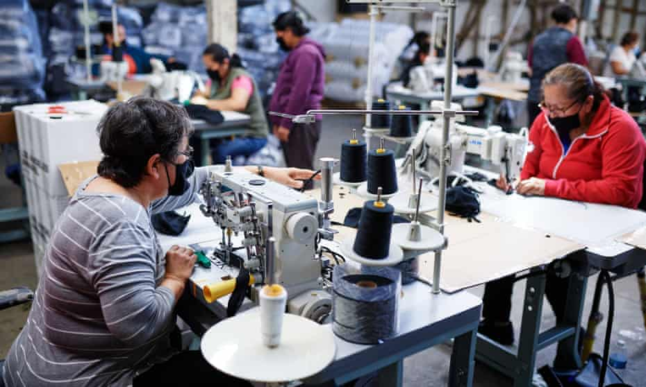 Factory workers make masks in Los Angeles.