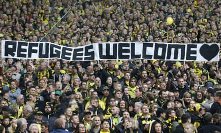 Borussia Dortmund supporters hold up a banner prior the German Bundesliga match against Hannover 96 in October, 2014.