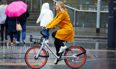 Helen Pidd in Manchester on a Mobike