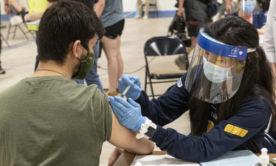Nursing student Allie Rodriguez administers a coronavirus vaccine dose in Kent, Ohio.