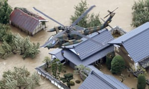 A resident is rescued by a Japanese self-defence forces helicopter in Nagano prefecture.