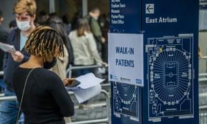 Queues form at a mass vaccination centre at Tottenham Hotspur football club in north London.