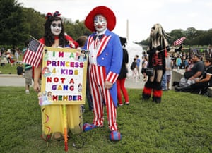 """Theresa Lindsey, Timothy SchlarmannTheresa Lindsey, left, dressed as Snow White and Timothy Schlarmann, center, dressed as Uncle Sam, both from southern California, join other juggalos, as supporters of the rap group Insane Clown Posse are known, in front of the Lincoln Memorial in Washington during a rally, Saturday, Sept. 16, 2017, to protest and demand that the FBI rescind its classification of the juggalos as """"loosely organized hybrid gang."""" (AP Photo/Pablo Martinez Monsivais)"""