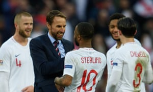 Gareth Southgate celebrates with Raheem Sterling after the dramatic 2-1 win over Croatia.