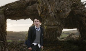 Poignant … Lewis MacDougall with the Monster, voiced and performed by Liam Neeson, in A Monster Calls.