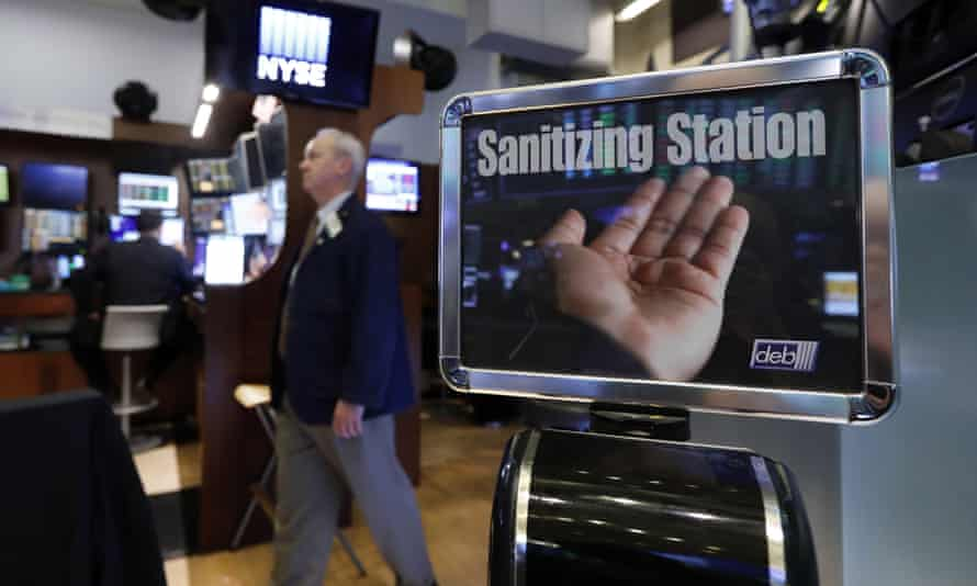 A trader passes a hand sanitizing station on the floor of the New York Stock Exchange.