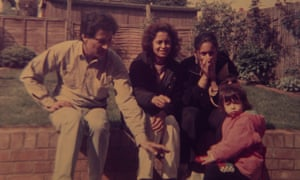Halima with her mother, father and older sister in 1992.