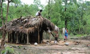 A family builds a shelter in Khammam district, having fled the Maoist insurgency-hit Chhattisgarh state.
