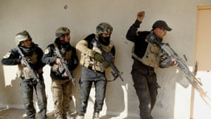 A building in Ramadi's government complex is searched