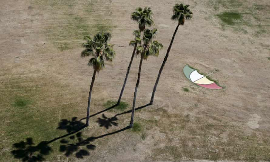 An umbrella painted on dry grass