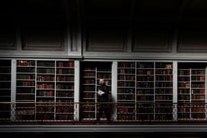 A man carries books at the Literary and Philosophical Society as it reopens