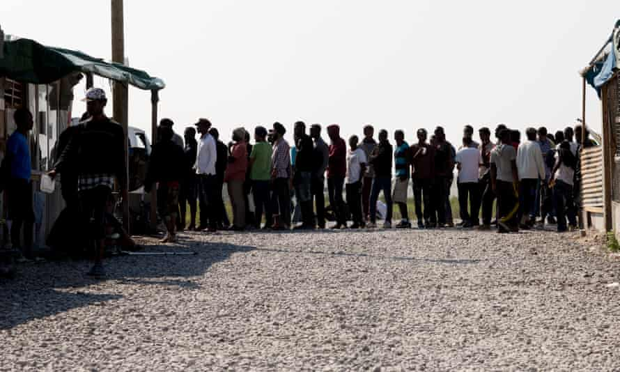 A queue for food at the overcrowded Calais refugee camp.