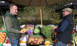 Warren O'Connor (left) and Andy Aston of Warren's Fruit and Veg at their Friday stall in the car park of Ye Olde Greene Manne in Northwood, Middlesex. They will be handing out free fruit and vegetables during half-term for any child who would normally get a free school lunch
