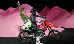 Rihanna making her exit from the Fenty x Puma show on the back of a motorbike.