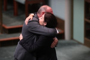 The member for Griffith, Terri Butler, hugs the member for Leichhardt, Warren Entsch, after he introduced the marriage amendment bill
