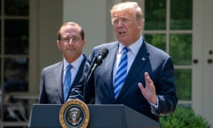 Donald Trump and Alex Azar, the US health secretary, in the White House rose garden on 11 May.