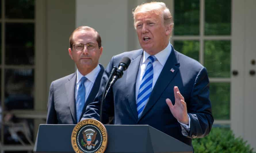 Alex Azar with Donald Trump during a White House announcement on drug policy in May