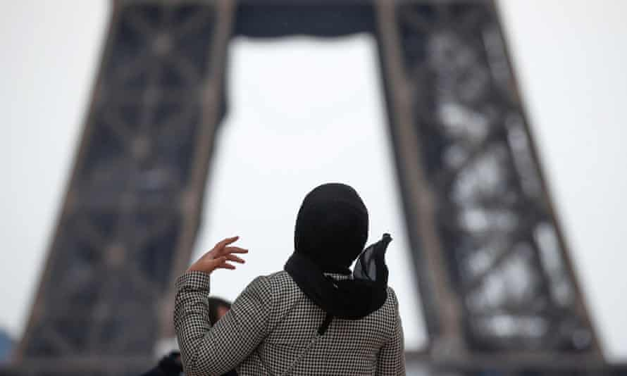 A woman wearing a hijab in Paris.