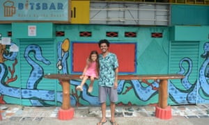 Matías Llaituqueo, right, who provides Spanish language classes; pictured with is daughter.