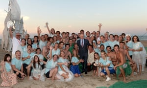 Russia's president Vladimir Putin (C) and participants in the Tavrida Na Bakalskoi Kose youth educational forum pose for a photograph by the Black Sea. Alexei Nikolaky/Russian Presidential Press and Information Office/TASS.