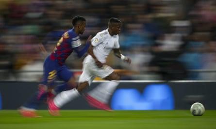 Vinícius Júnior accelerates past Nélson Semedo during the 2-0 win at the Bernabéu.