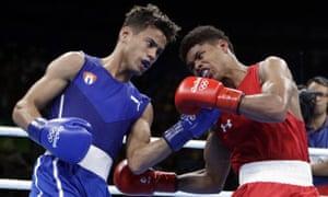 Cuba's Robeisy Ramirez, left, and the US's Shakur Stevenson exchange punches during the men's bantamweight final.