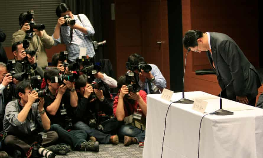 Toyota president Akio Toyoda bows at the start of a news conference in Nagoya