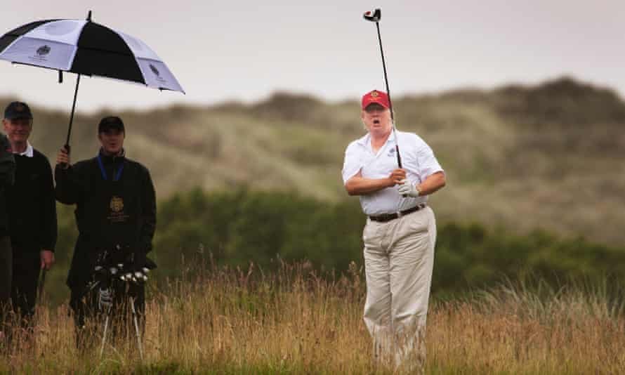 Donald Trump playing at the Trump International golf links in Aberdeenshire, Scotland.